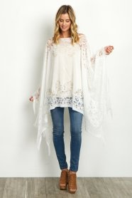 http://www.shoppinkblush.com/p-19262-ivory-lace-fringe-trim-maternity-poncho.aspx?DepartmentID=2