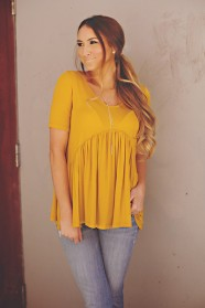 https://www.ohblythe.com/collections/shirts/products/mustard-babydoll-top